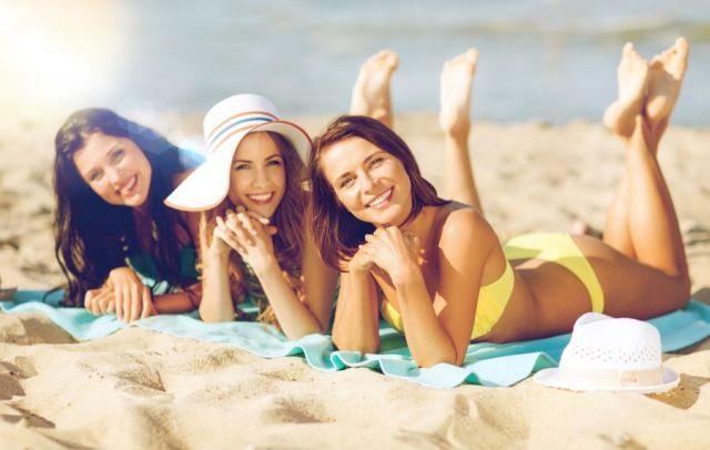 girls sunbathing on the beach